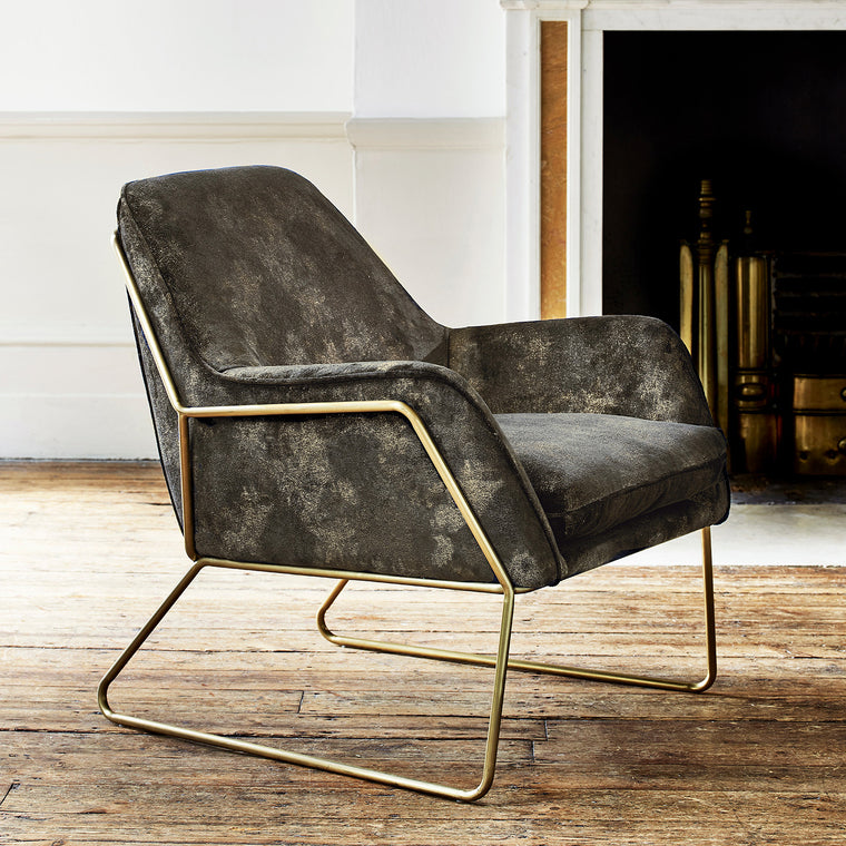 Chair upholstered in a luxurious grey velvet upholstery fabric with stunning metallic foil design