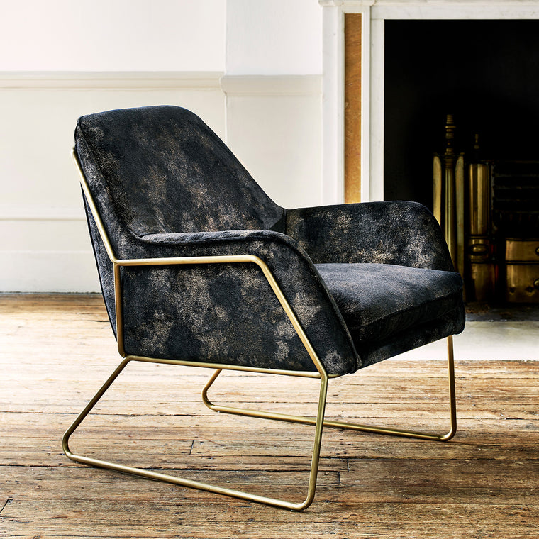 Chair upholstered in a luxurious dark blue velvet upholstery fabric with stunning metallic foil design