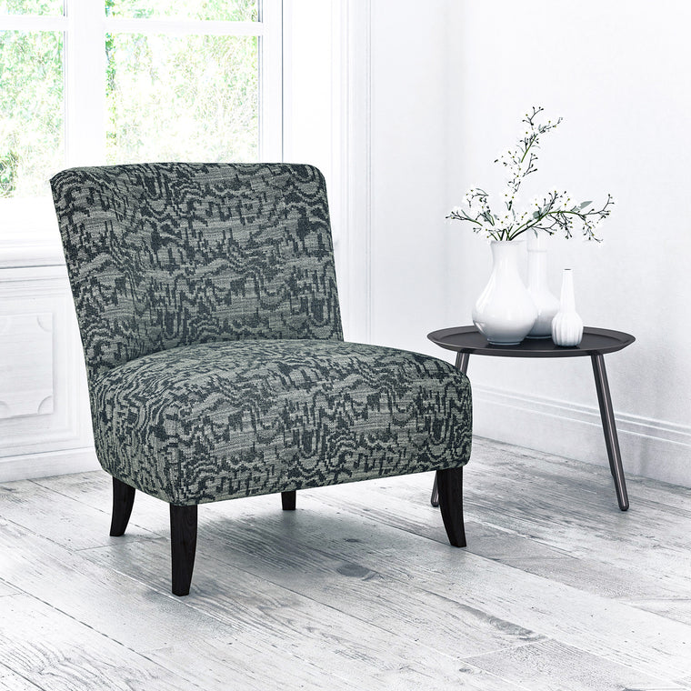 Chair upholstered in a grey abstract weave upholstery fabric