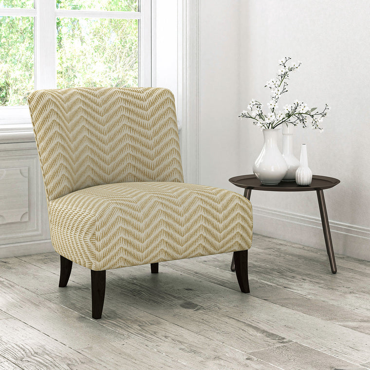 Chair upholstered in a gold herringbone weave upholstery fabric