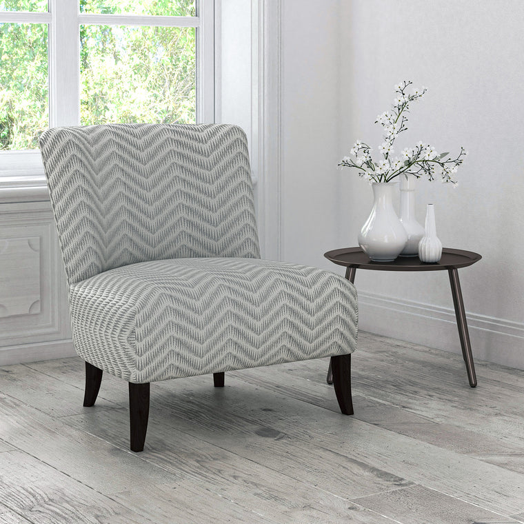 Chair upholstered in a neutral herringbone weave upholstery fabric