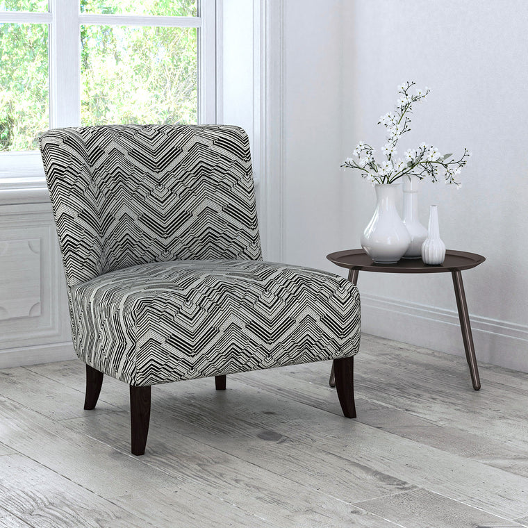 Chair upholstered in a stain resistant grey herringbone weave upholstery fabric