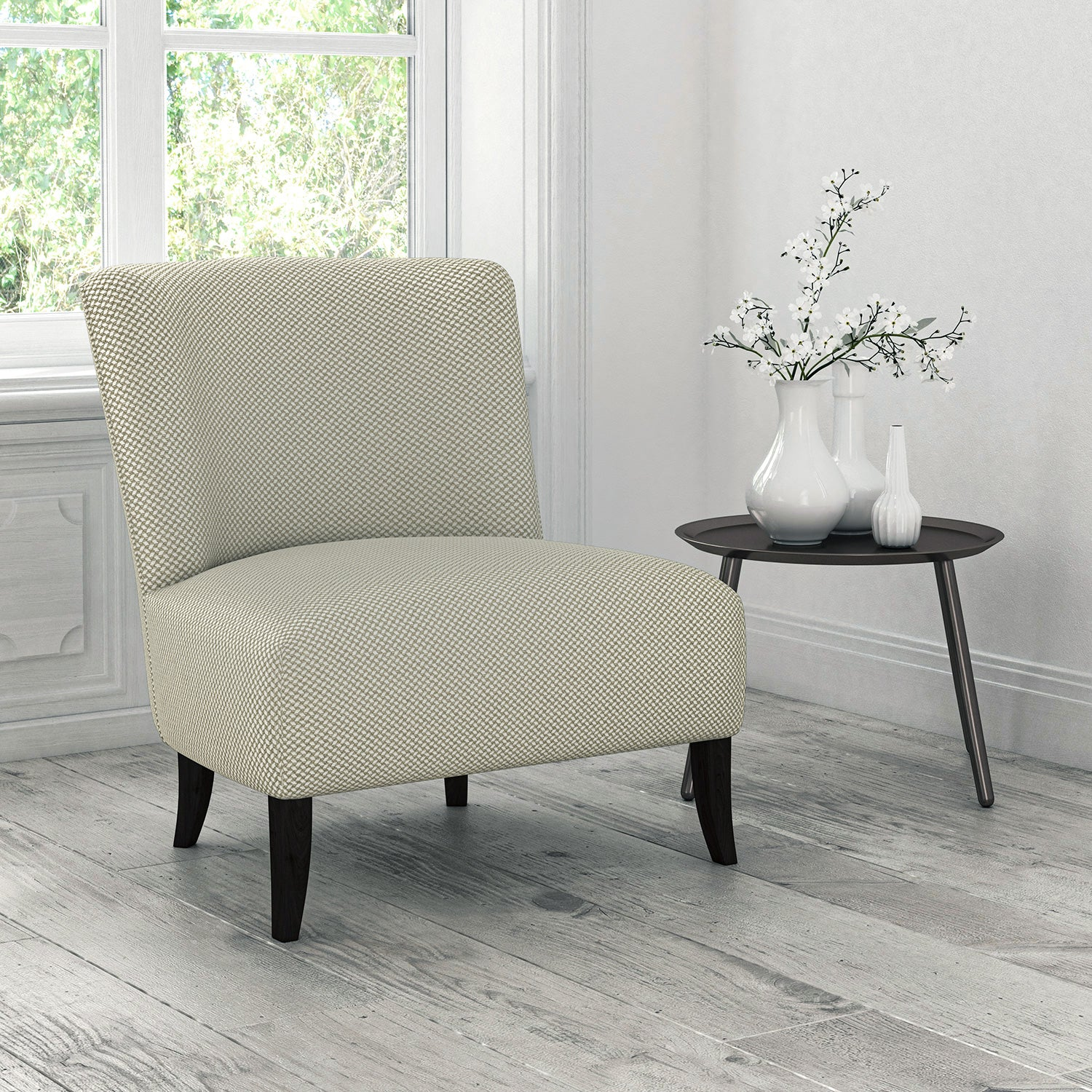 Chair upholstered in a cream stain resistant geometric weave fabric