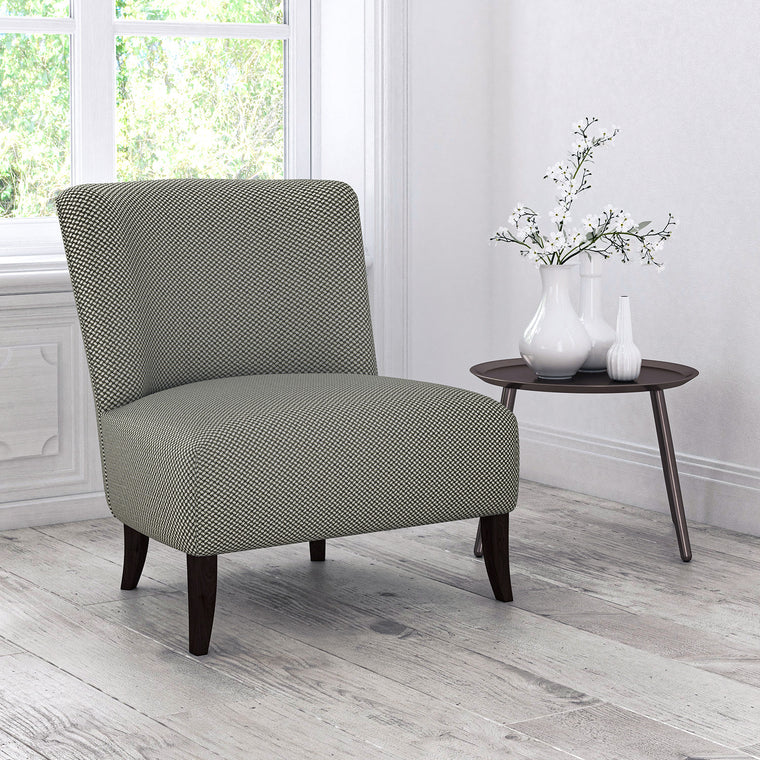 Chair upholstered in a grey stain resistant geometric weave fabric