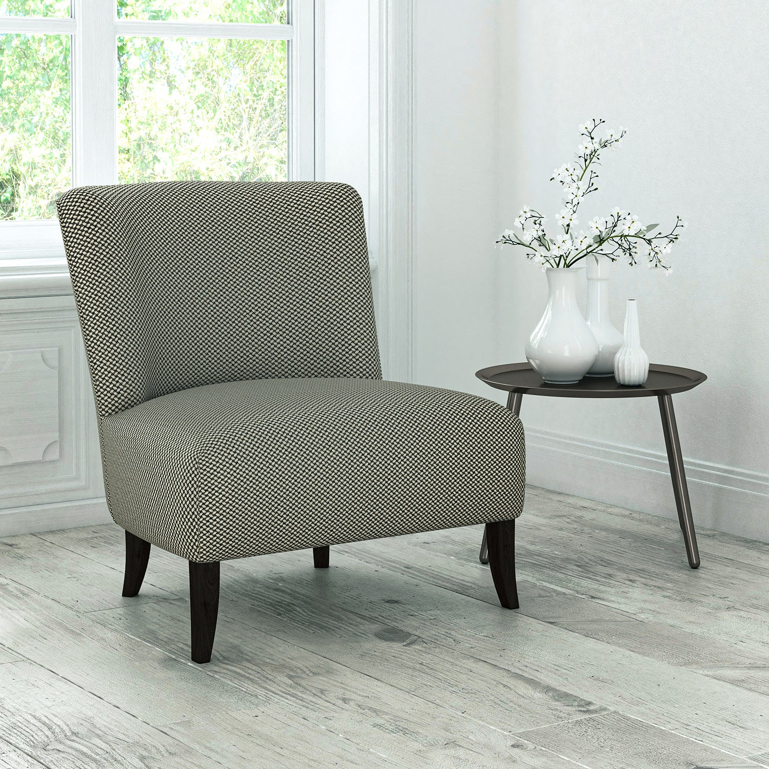 Chair upholstered in a dark grey stain resistant geometric weave fabric