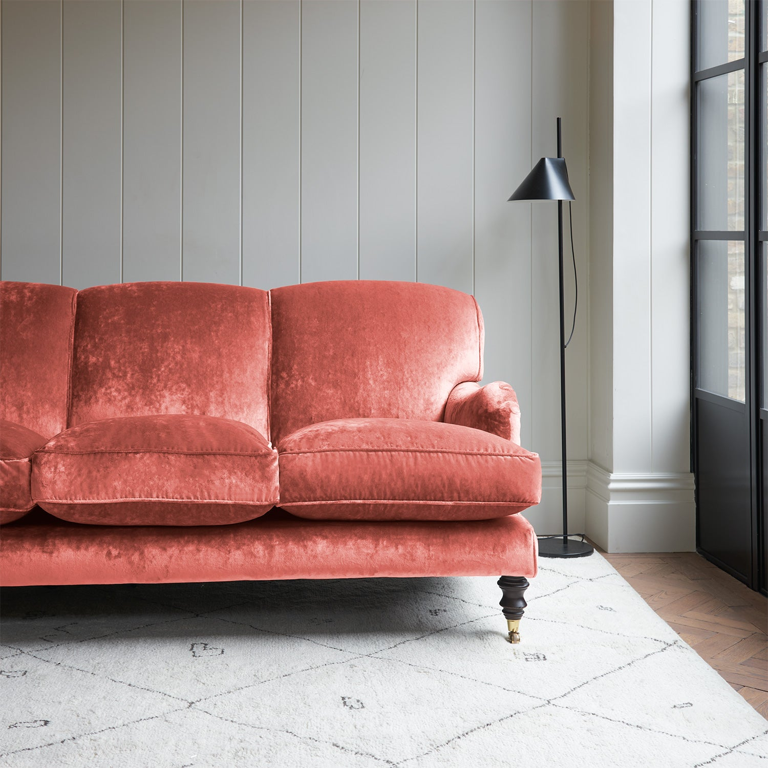 Velvet sofa in a pink crushed velvet upholstery fabric