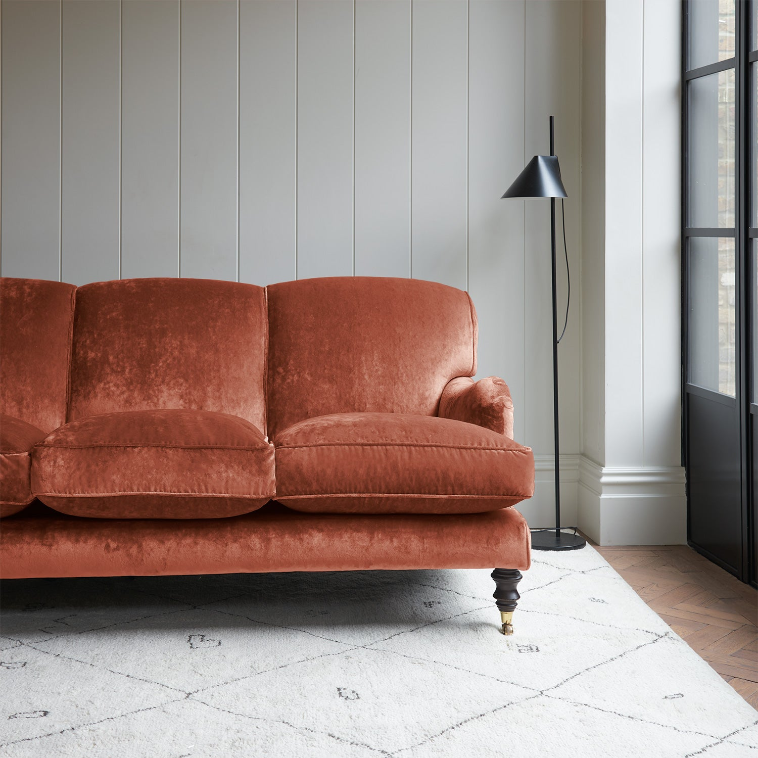 Velvet sofa in a orange crushed velvet upholstery fabric