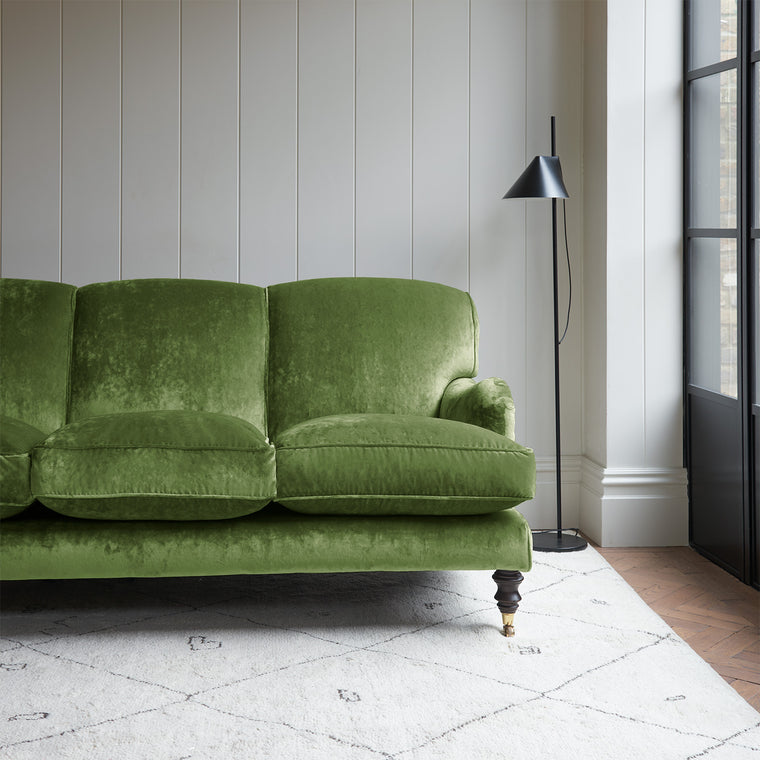 Velvet sofa in a green crushed velvet upholstery fabric