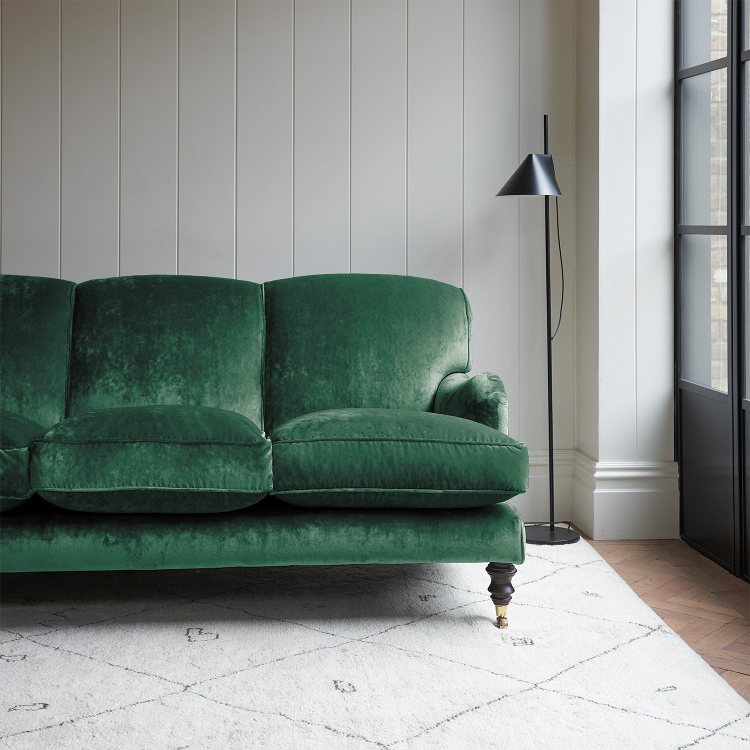 Velvet sofa in a dark green crushed velvet upholstery fabric