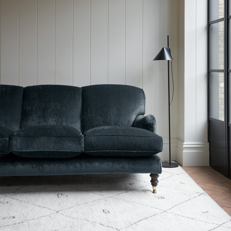 Velvet sofa in a dark blue crushed velvet upholstery fabric