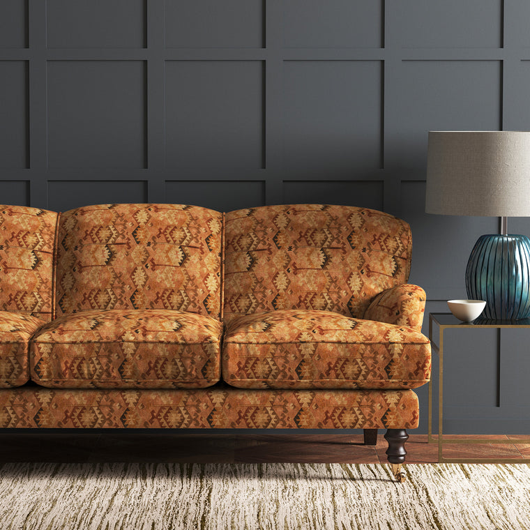 Velvet sofa upholstered in a brown velvet fabric with vintage kilim design and stain resistant finish