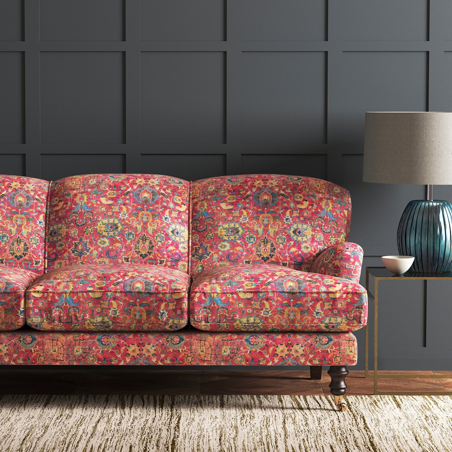 Velvet sofa upholstered in a pink and multicoloured velvet fabric with carpet design and stain resistant finish