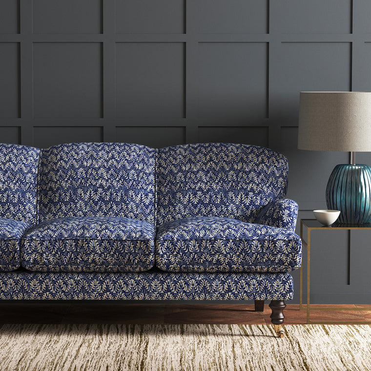 Velvet sofa in a blue velvet fabric with colour block design and stain resistant finish