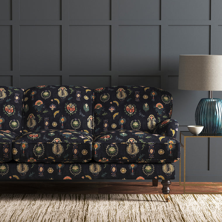 Sofa upholstered in a dark, luxurious stain resistant velvet with whimsical design