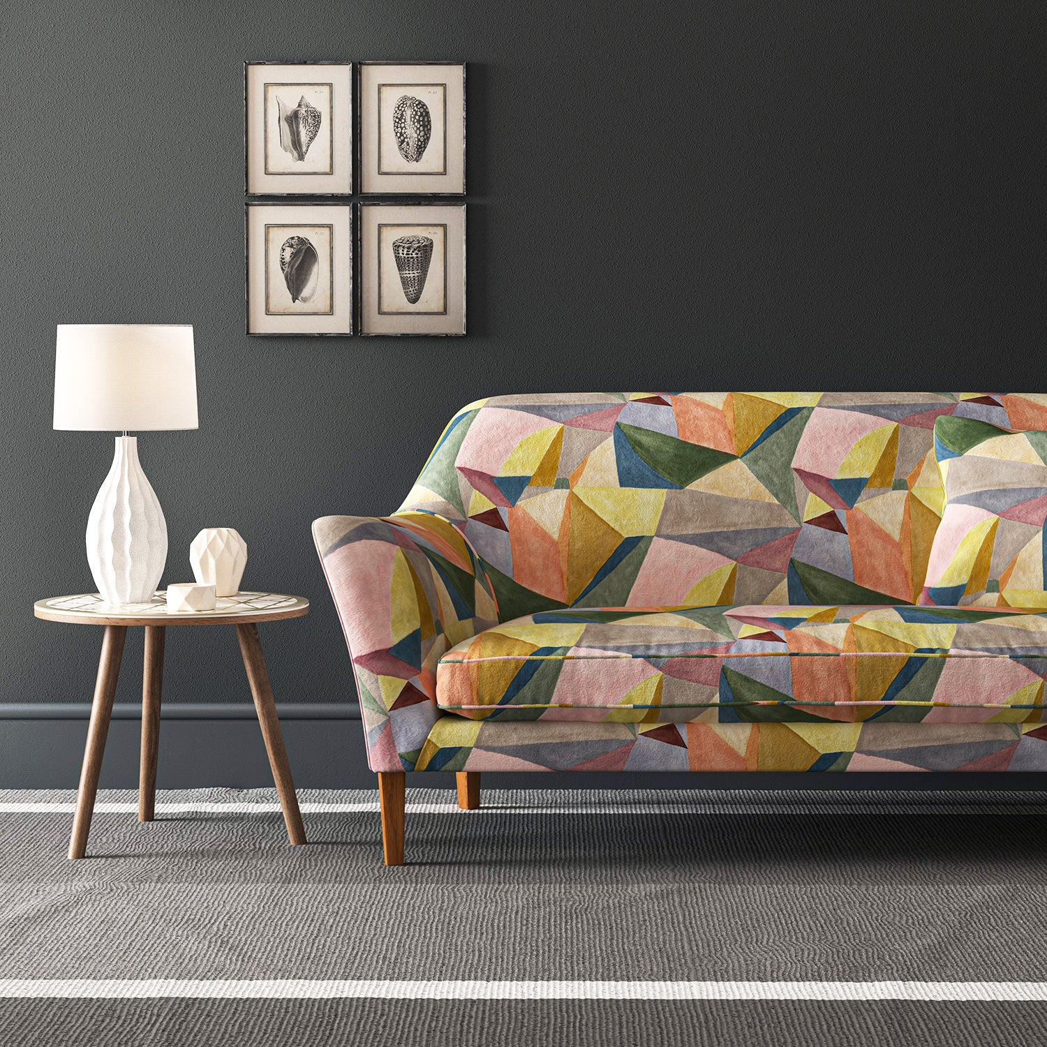 Sofa upholstered in a velvet stain resistant fabric with a multicoloured geometric design