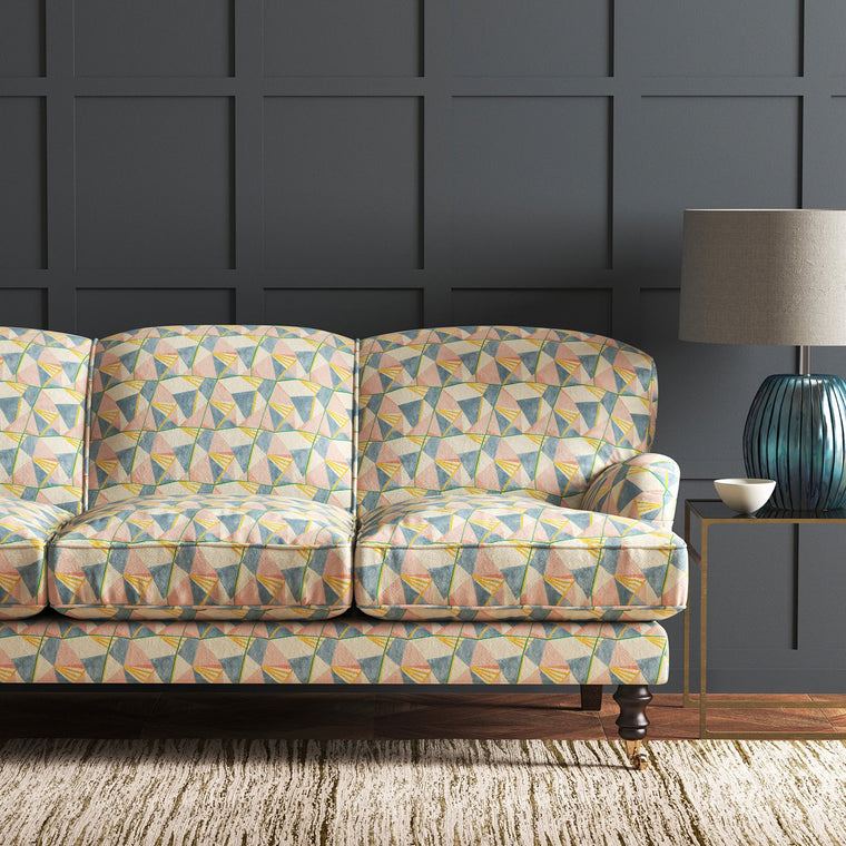 Velvet sofa upholstered in a pastel coloured velvet fabric with geometric design and stain resistant finish