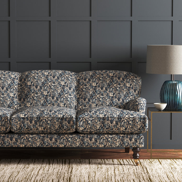 Sofa in a stain resistant velvet fabric with a blue abstract design