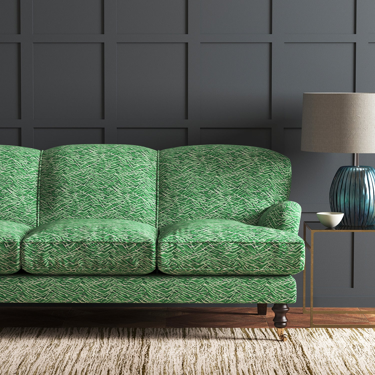 Sofa in a green velvet sofa with stain resistant finish and abstract design