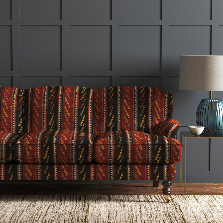 Sofa in a striped velvet fabric in dark red and brown colours with a stain resistant finish