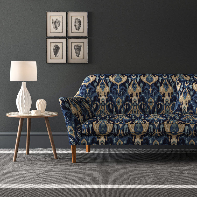 Sofa upholstered in a stain resistant velvet fabric with contemporary abstract design