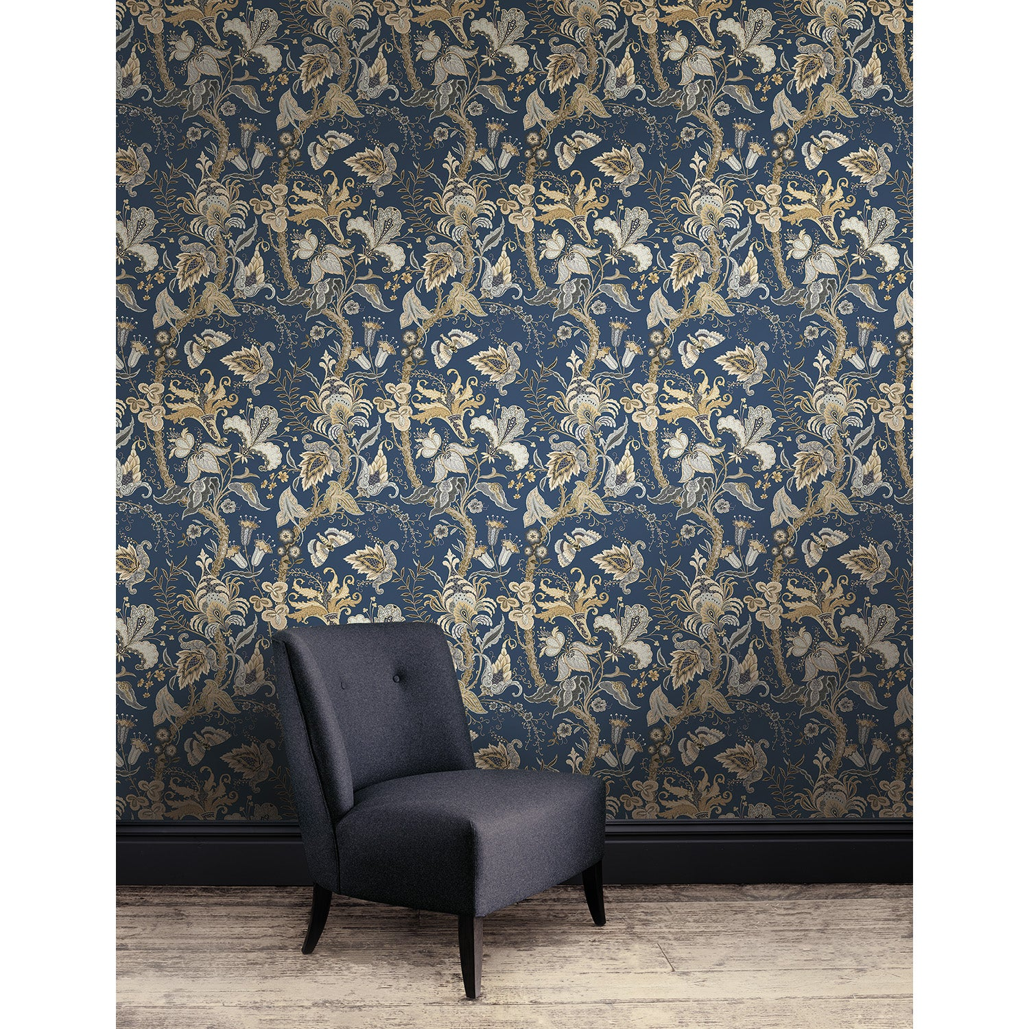 Blue chair with a dark feature wallcovering featuring a stylised floral design