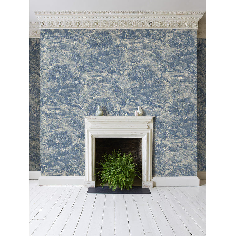 Lounge featuring a blue feature wallpaper with Island Paradise scene.