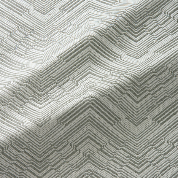 Fabric swatch of a stain resistant herringbone weave design in neutral colours, suitable for curtains and upholstery