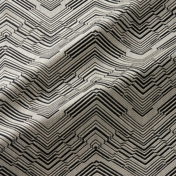 Fabric swatch of a stain resistant herringbone weave design in dark grey colours, suitable for curtains and upholstery