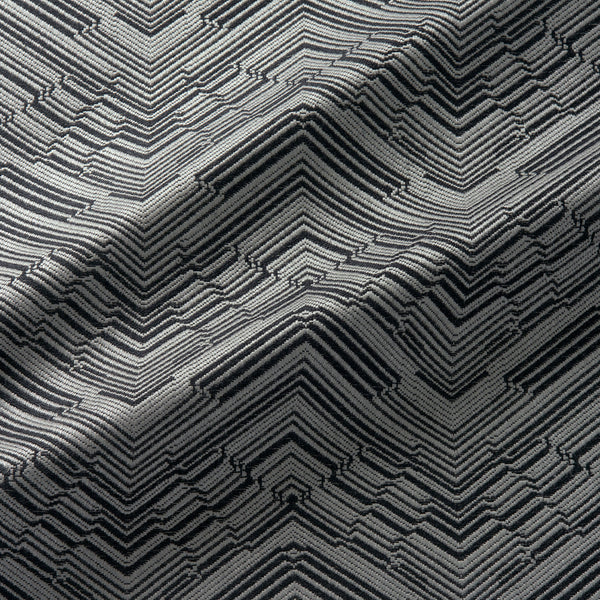 Fabric swatch of a stain resistant herringbone weave design in a black colour, suitable for curtains and upholstery