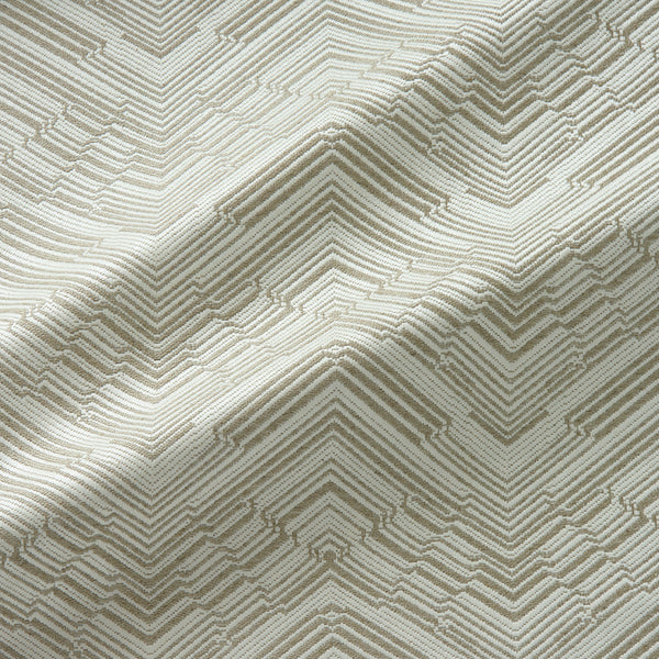 Fabric swatch of a stain resistant herringbone weave design in cream colours, suitable for curtains and upholstery