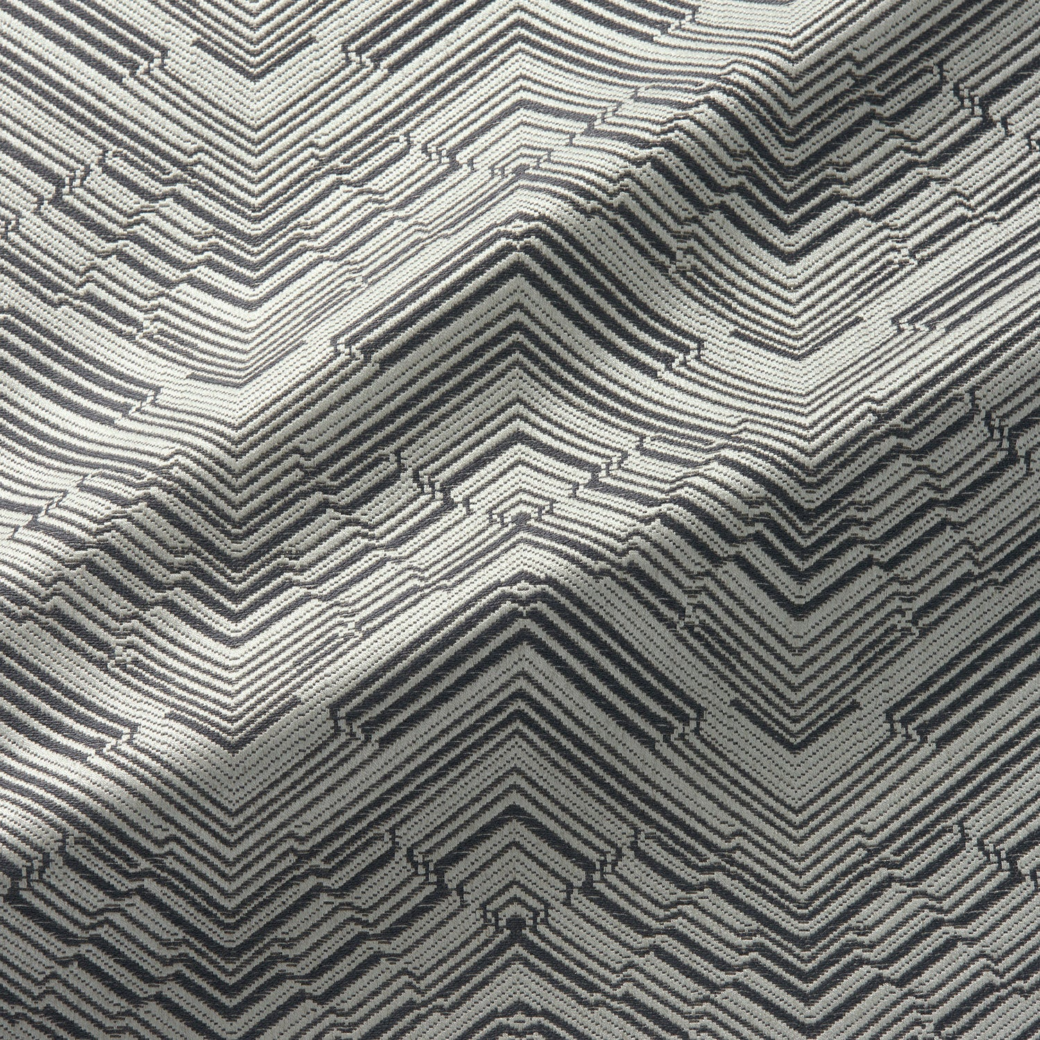 Fabric swatch of a stain resistant herringbone weave design in dark neutral colours, suitable for curtains and upholstery