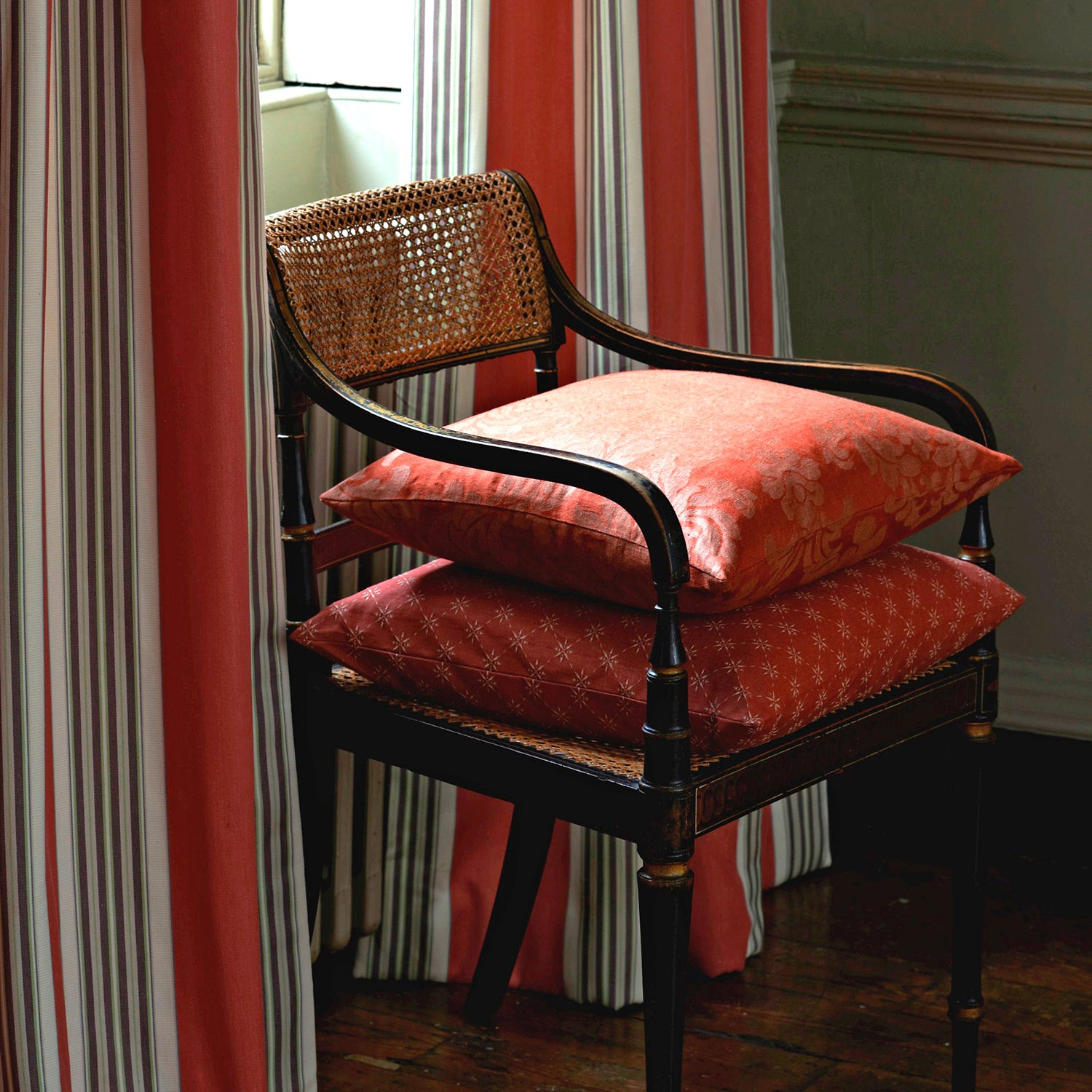 Lifestyle image of a chair and curtains in classic fabrics