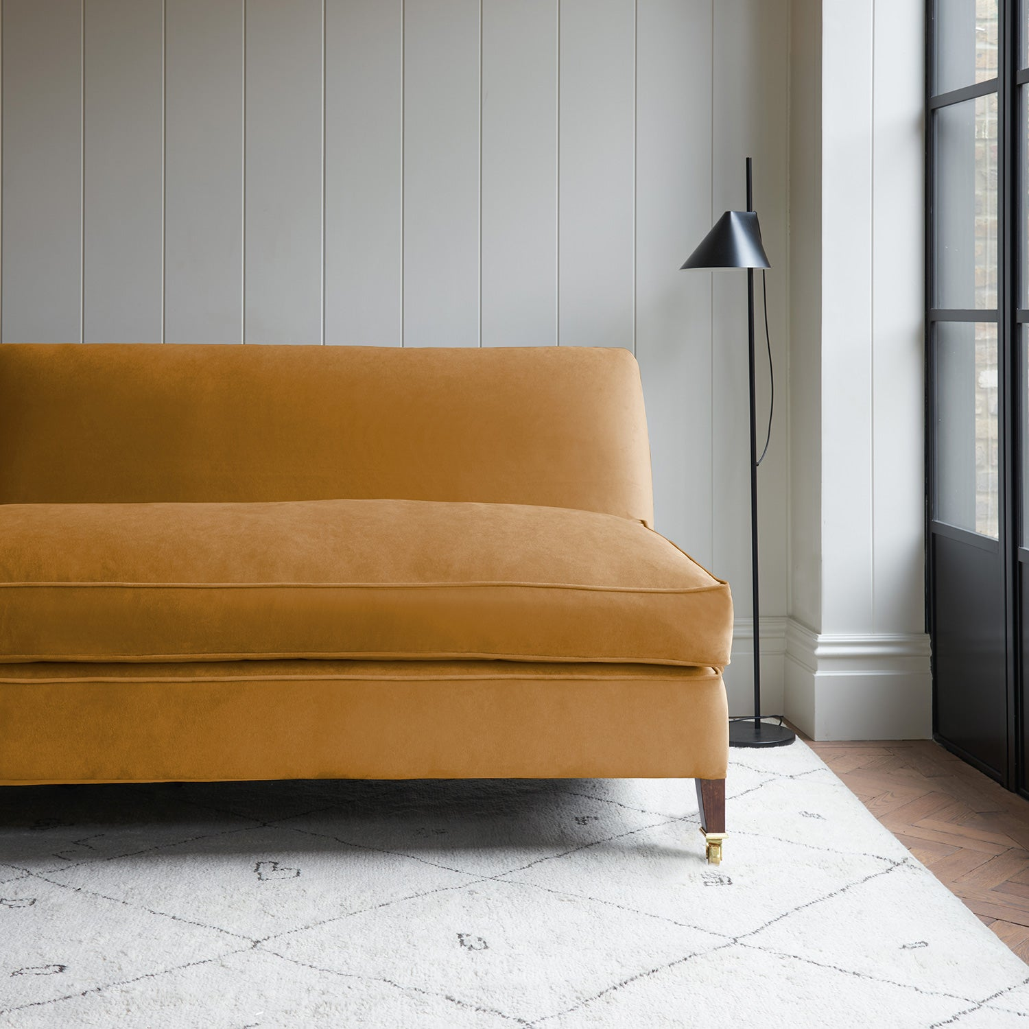 Velvet sofa in a gold velvet fabric with stain resistant finish