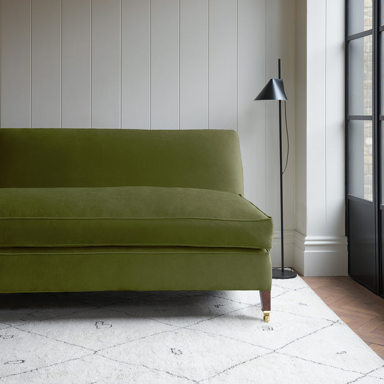 Velvet sofa in a dark green velvet fabric with stain resistant finish