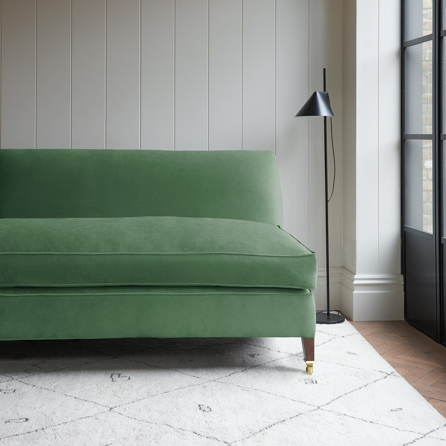 Velvet sofa in a sage green velvet fabric with stain resistant finish