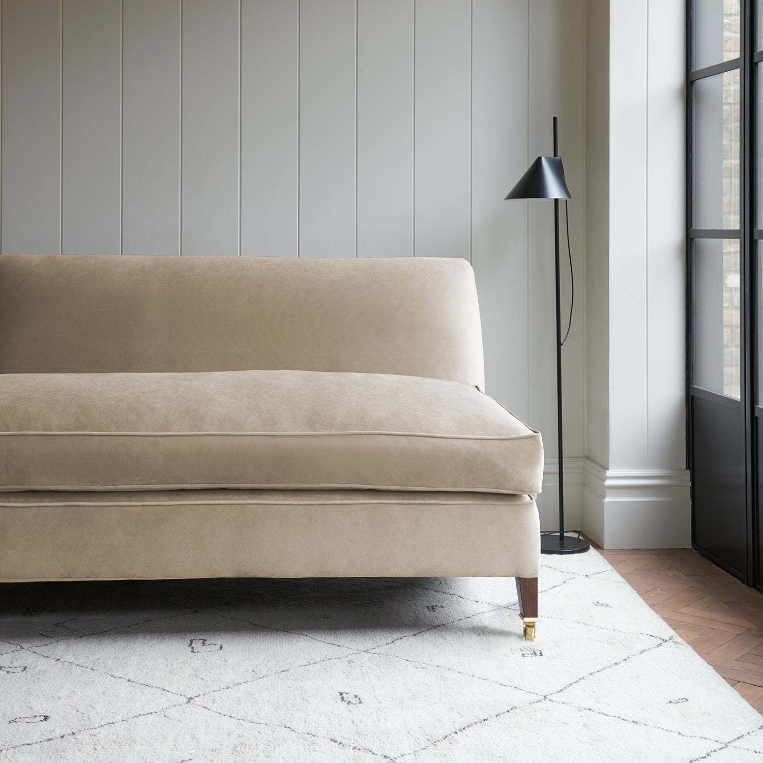Velvet sofa in a cream velvet fabric with stain resistant finish
