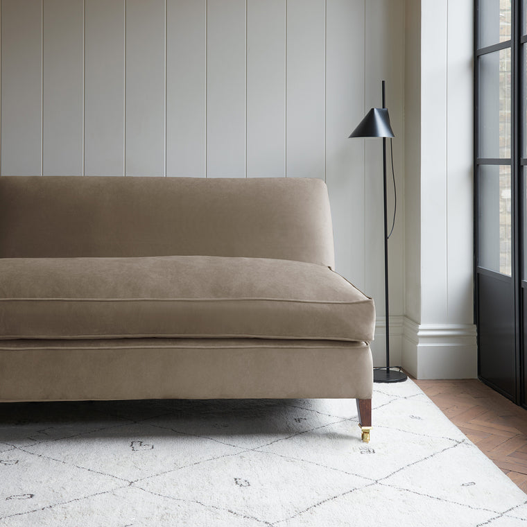 Velvet sofa in a neutral velvet fabric with stain resistant finish