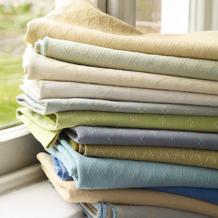 Fabric stack of weave upholstery fabrics in assorted spring colours