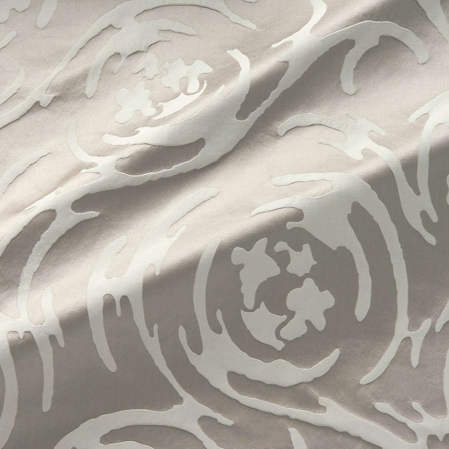 Fabric swatch of a beautiful neutral coloured abstract swirl fabric suitable for curtains