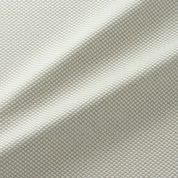 Fabric swatch of a cream stain resistant geometric weave fabric suitable for curtains and upholstery