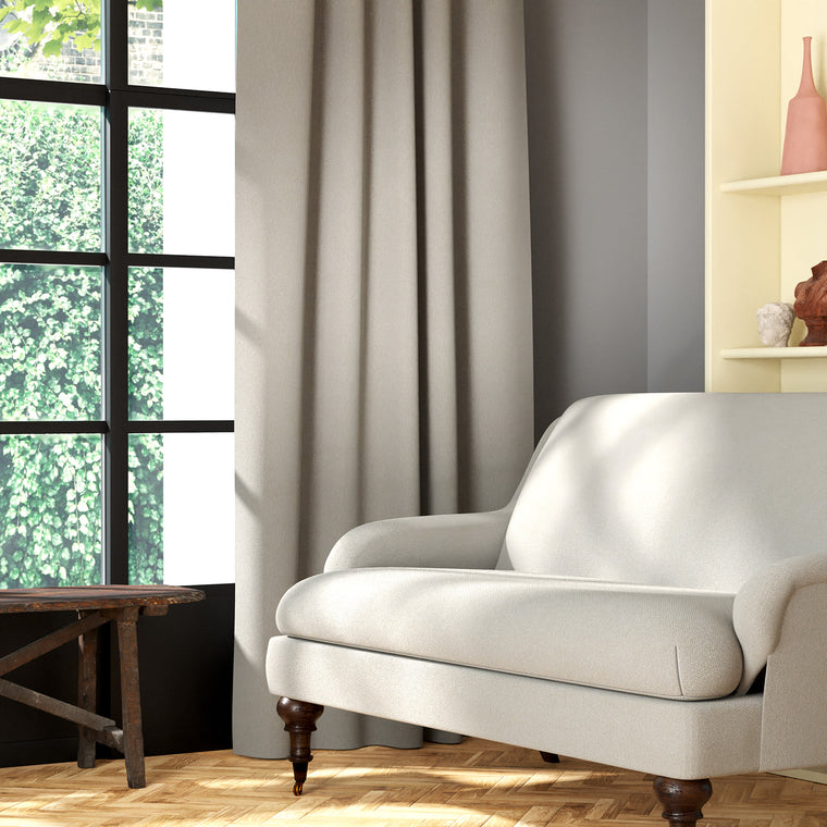 Living room featuring a sofa and curtains in a plain light neutral eco-friendly fabric