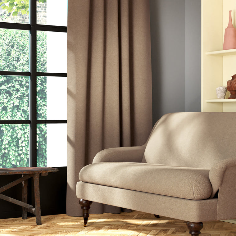 Living room featuring a sofa and curtains in a plain neutral eco-friendly fabric