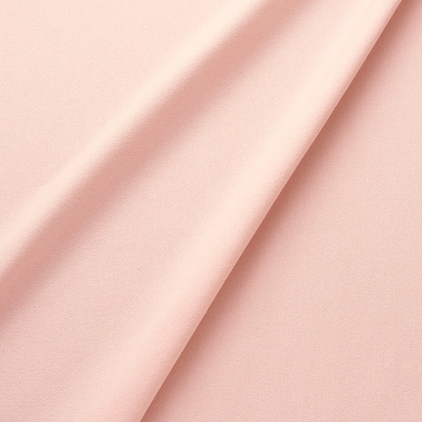 Fabric swatch of a eco-friendly plain pastel pink fabric for curtains and upholstery