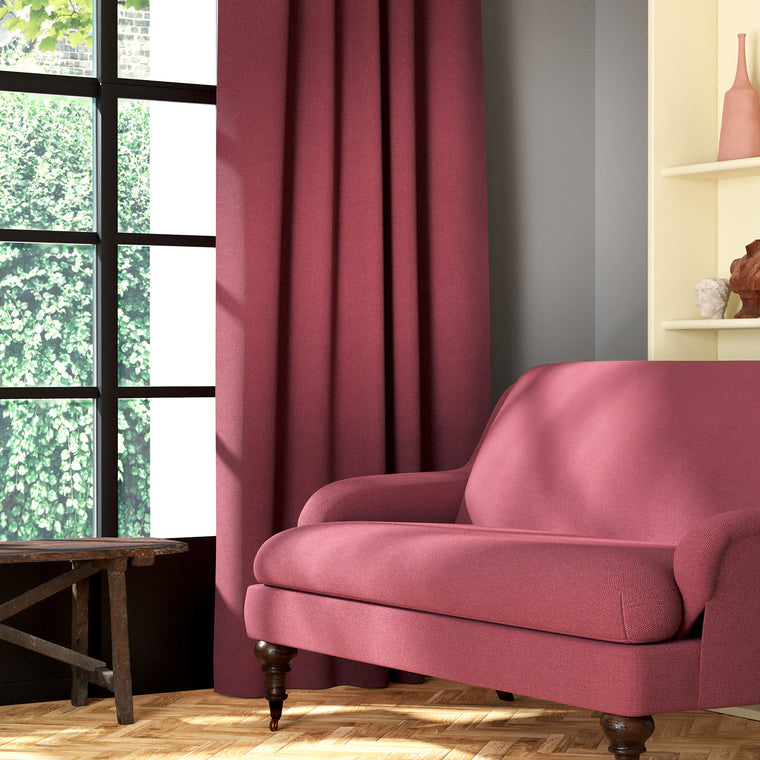 Living room featuring a sofa and curtains in a plain pink eco-friendly fabric