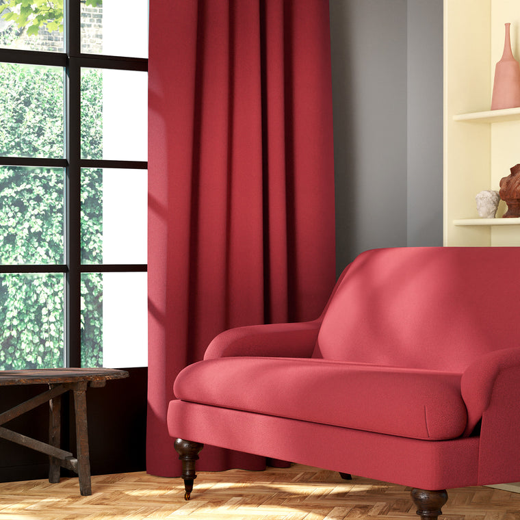 Living room featuring a sofa and curtains in a plain red eco-friendly fabric