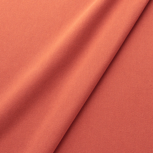 Fabric swatch of a eco-friendly plain orange fabric for curtains and upholstery