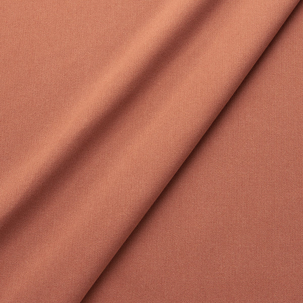 Fabric swatch of a eco-friendly plain burnt orange fabric for curtains and upholstery