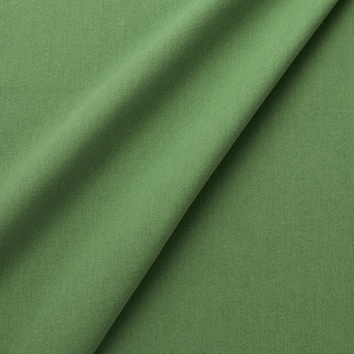 Fabric swatch of a eco-friendly plain green fabric for curtains and upholstery