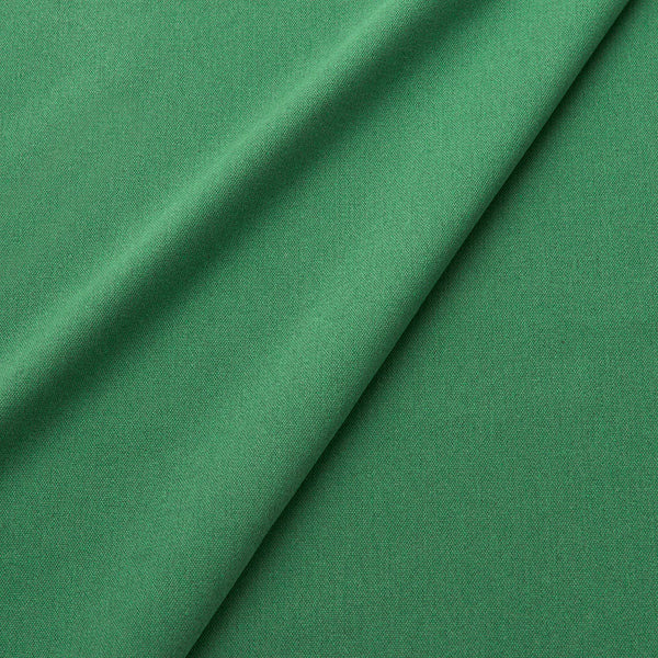 Fabric swatch of a eco-friendly plain emerald green fabric for curtains and upholstery
