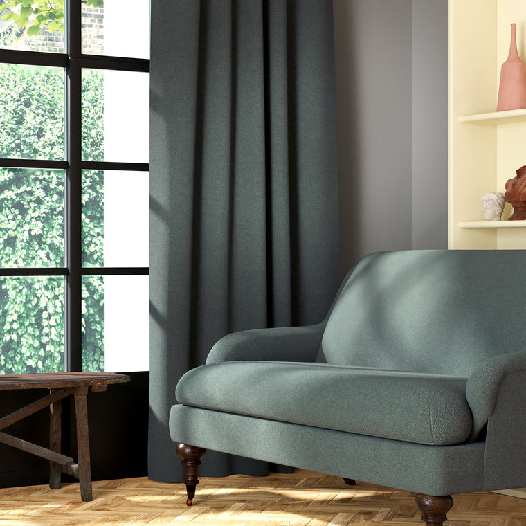 Living room featuring a sofa and curtains in a plain grey eco-friendly fabric
